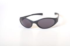 Sunglass. A black sporty sunglass with isolated background Royalty Free Stock Photo