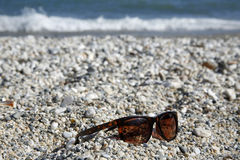Sunglass on the beach. Closeup of sunglass on the beach Royalty Free Stock Images