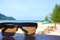 Sunglass on the beach Royalty Free Stock Photos