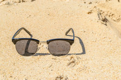 Sunglass on the beach Royalty Free Stock Images