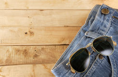 Sunglass with blue jean. Stock Photography