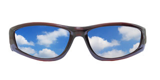 Sunglass and clouds. Concept of summer vacation holiday. Sunglass with reflection of blue sky and clouds Stock Photography