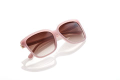Sunglass cor-de-rosa no fundo branco Fotografia de Stock Royalty Free