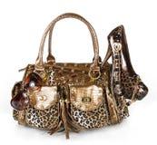 sunglass för handväskaleopardsko Arkivbilder