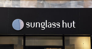 4d694ecc97 Sunglass Hut Retail Store Exterior With Huge Ray-Ban Advertisement ...