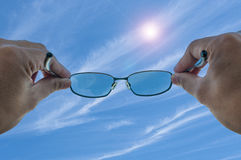 Sunglass pointed at the cloud Stock Image