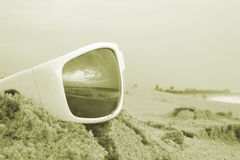Sunglass reflection Colorized. A set of sunglasses on the beach colorized for web page use royalty free stock photography