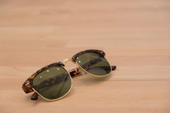 Sunglass. On wood Stock Images