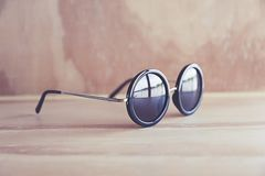 Sunglass. On the wood table Royalty Free Stock Photography
