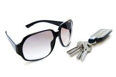 Sunglasse and keys. Sunglasses and  four keys isolated Stock Image
