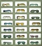 Sunglasses 01. Sunglases displayed in three columns and lit from the background Royalty Free Stock Image