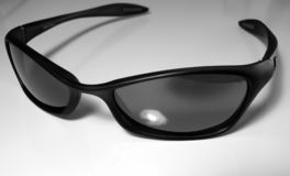 Sunglasses 1. Julbo sunglasses in black and white against white background Stock Image