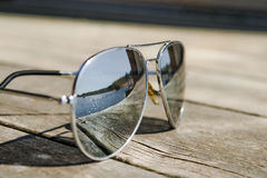 Sunglasses. On a bridge reflecting the sun royalty free stock images