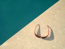 Sunglasses. By the pool Stock Images