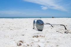 Sunglasses. On the sunny beach royalty free stock image