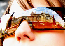 Sunglasses. Reflection of a building in sunglasses. North Railway Station in Paris Stock Photo