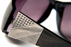 Sunglasses. An purple close up of glasses on white background Stock Image