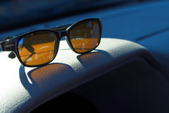 Sunglasses. On the dashboard on an automobile Royalty Free Stock Photography