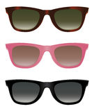 Sunglasses. Classic sunglasses with turtle shell, pink and black frames Royalty Free Stock Photography