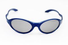 Sunglasses. A pair of blue sunglasses isolated on a white background Stock Images
