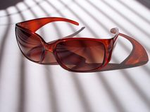 Sunglasses 2. Sunglasses in morning sun royalty free stock photo