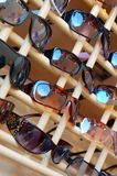Sunglasses. A wall of sunglasses s Royalty Free Stock Photography