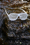 Sunglasses. White sunglasses in a lake Royalty Free Stock Photography