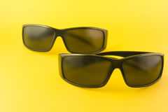 Sunglasses. Isolated on the yellow background Stock Photos