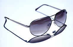 Sunglasses. Man sunglasses on white table Stock Image