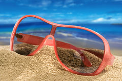 Sunglasses. On the sand (seaside Stock Photography