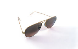 Sunglasses. A golden classic sunglasses with brown glasses Royalty Free Stock Photography