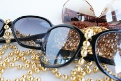 Sunglasses. Decorated by a yellow beads Royalty Free Stock Images