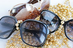 Sunglasses. Decorated by a yellow beads stock photo