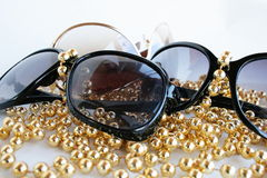 Sunglasses. Decorated by a yellow beads royalty free stock photo