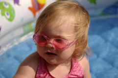 Sunglasses. A portrait of an adorable baby girl wearing pink sunglasses Royalty Free Stock Images