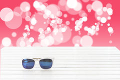 Sunglasses with abstract bokeh background Royalty Free Stock Photos