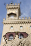 Sunglasses against San Marino Government Palace. The Government Palace of San Marino republic through fashion sunglasses Royalty Free Stock Images