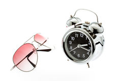 Sunglasses with alarm clock isolated on white Stock Images