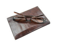 Sunglasses atop billfold Stock Images