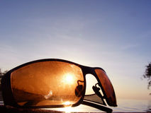 Sunglasses background. A background of brown sunglasses, blocking the Sun Stock Images