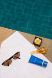 Sunglasses, bath towel, sun block cream, bath jel and candle. Flower Stock Photos