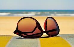 Sunglasses on the beach stock photos