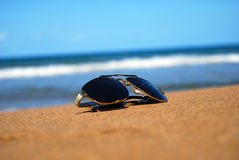 Sunglasses on beach Stock Photography