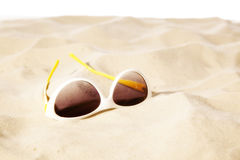 Sunglasses on the beach. White background Stock Photography