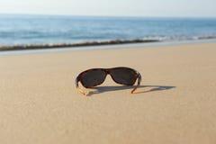 Sunglasses on the beach Stock Image