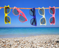 Sunglasses on the beach royalty free stock images