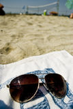 Sunglasses and towel on the beach, holiday concept. Sunglasses on the beach towel stock image