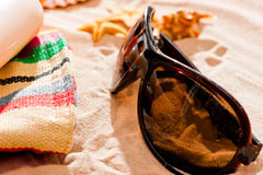 Sunglasses and  beach accessories on dry fine sand Stock Photography