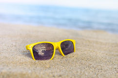 Sunglasses beach against backdrop of the sea. stock photography