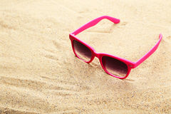 Sunglasses on the beach, close up Royalty Free Stock Images